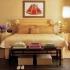 Textile designer Gretchen Bellinger's yellow bedroom with red accent - ElleDecor via Atticmag