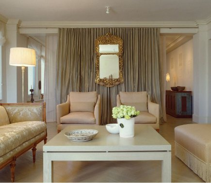 A pair of back-to-back curtains creates a center room divider