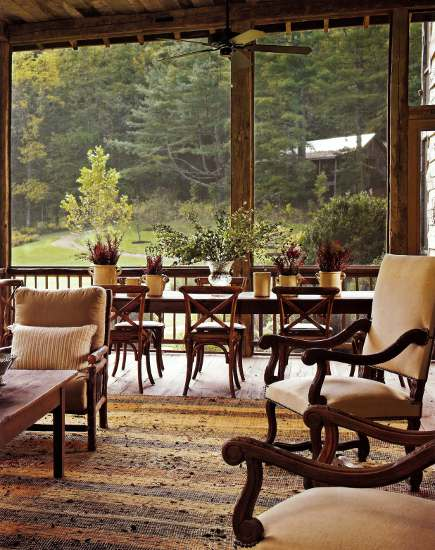 screen porch added to a log home in Tennessee - AD via Atticmag