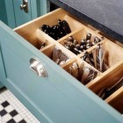 kitchen cabinet ideas - lower kitchen cabinet drawer divided to hold eating utentils - bh&g via Atticmag