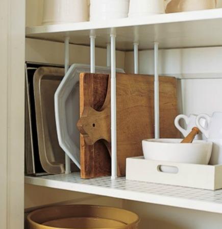 kitchen cabinet ideas - kitchen pantry divided tray and platter storage - Martha Stewart via Atticmag