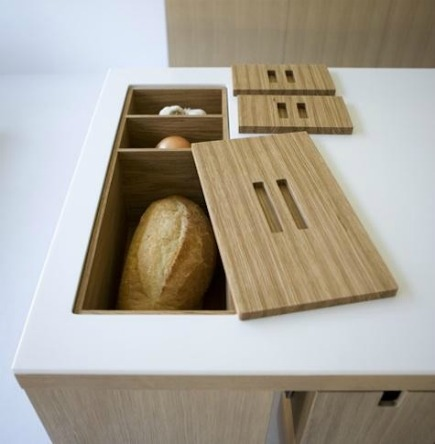 kitchen cabinet ideas - built in kitchen counter storage bins for bread and onions - via Atticmag