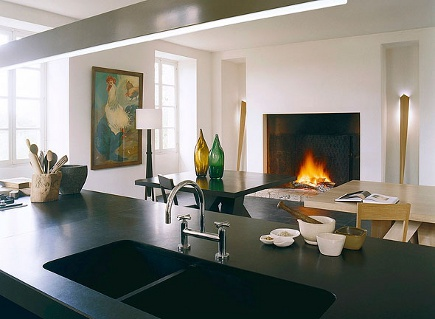two tables - black and white modern kitchen with Heijden Hume Metro dining tables in adjacent dining space with fireplace- Heijden Hume via Atticmag