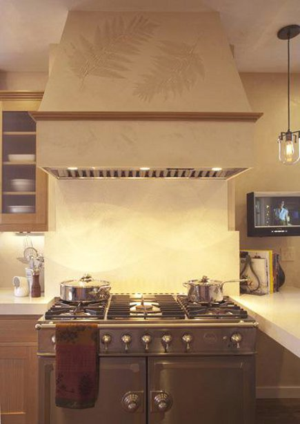 industrial mix kitchen - Cornue Fe stainless steel range with built in hood - Joann Hartley via Atticmag