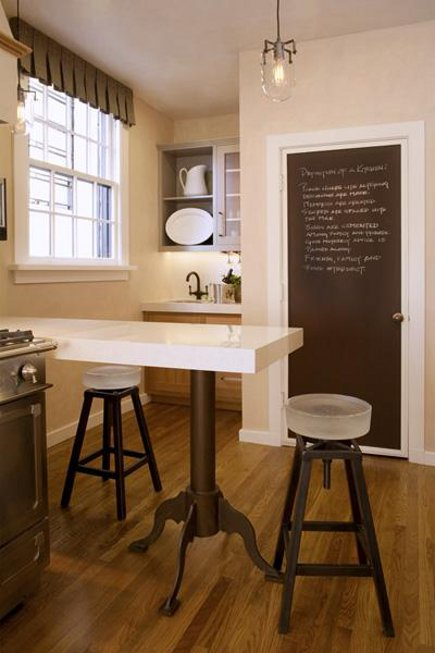 industrial mix kitchen - eating bar with vintage French industrial style steel base in a San Francisco kitchen - Joann Hartley via Atticmag