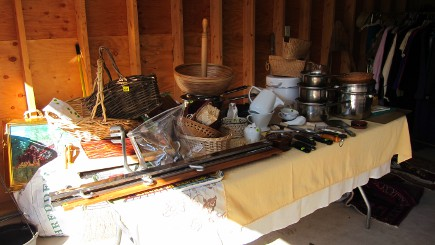 yard sale - table of kitchenwares at my house sale - Atticmag
