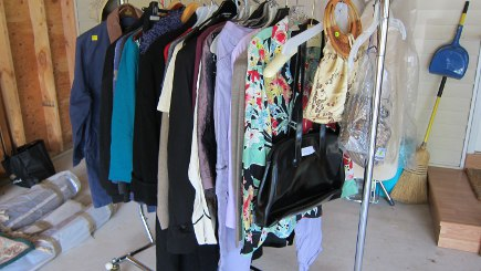 rack of 80s vintage clothes at my yard sale - Atticmag