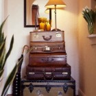 vintage suitcase - a hallway table made from a stack of suitcases - Ron Marvin via Atticmag