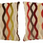 designer pillows - decorative linen pillows with velvet wave design from Pillows by Dezign via Atticmag