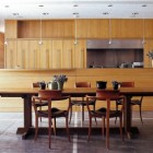 modern oak and marble kitchen open to dining room with vinyl shades that descend from the ceiling - Met Home via Atticmag