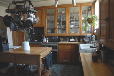 view of vintage gumwood cabinet kitchen before remodeling - Atticmag