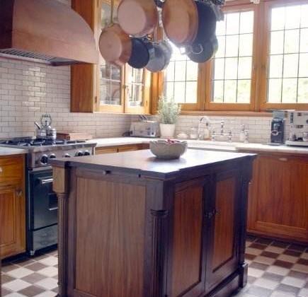 gumwood cabinet kitchen restoration in a 1927 home with gumwood and walnut island - Atticmag