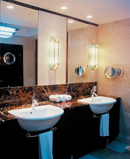 double vanity bathrooms - a pair of semi-recessed D-shape Duravit sinks in a marble vanity - Pepe Calderin via Atticmag