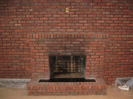 brick fireplace wall before it was painted black