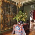 draped table - Anatolian rug drapes a rectangular foyer table in a Paris apartment - Elle Décor via Atticmag