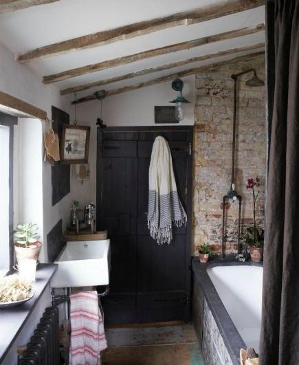 rustic bathroom with exposed brick wall from book Rachel Ashwell Shabby Chic Inspirations and Beautiful Spaces - via Atticmag