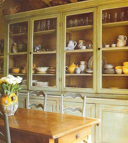 distressed green painted cabinet with chicken wire insert doors - Velvet & Linen via Atticmag