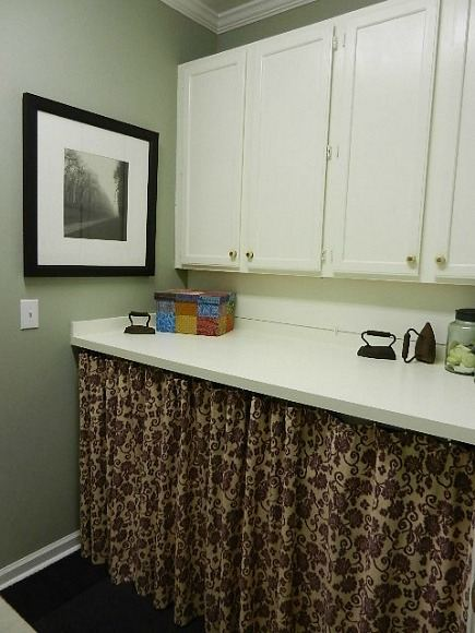hidden laundry spaces - my daughter's laundry room with washer dryer behind fabric skirt - Atticmag