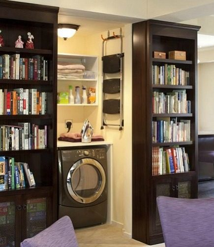 hidden laundry spaces - laundry area hidden by sliding bookcases from Lindy Donnelly via Atticmag