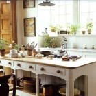 Jasper Conran's country kitchen with architectural island - WOI via Atticmag