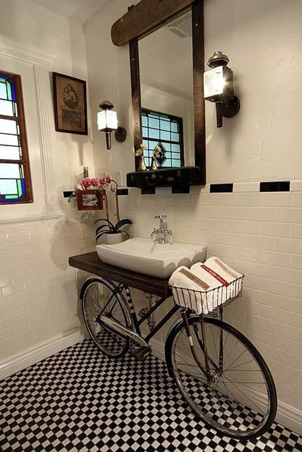 Benjamin Bullins mixed media discarded bicycle vanity for a bathroom - via Atticmag