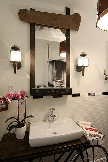 Artist Benjamin Bullins mixed media trombone case mirror over a bicycle vanity - via Atticmag