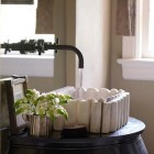 antique marble sink on black lacquer console table by Melanie Pounds - House Beautiful via Atticmag