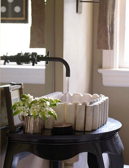 antique marble sink on black lacquer console table by designer Melanie Pounds - House Beautiful via Atticmag