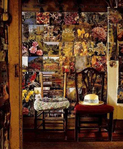 magazine page clutter used as wallpaper in an English country house - WOI via Atticmag