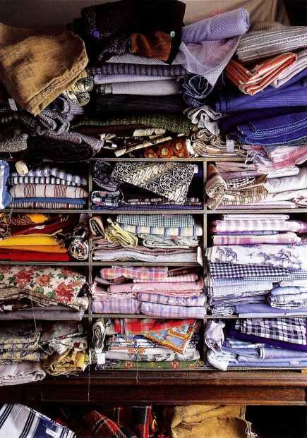 vintage fabric collection clutter at L'Emotion du Passe, in Brittany - WOI via Atticmag