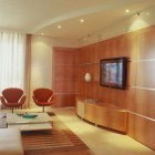 modern media walls - flat screen TV on a wood paneled wall by Pepe Calderin via Atticmag