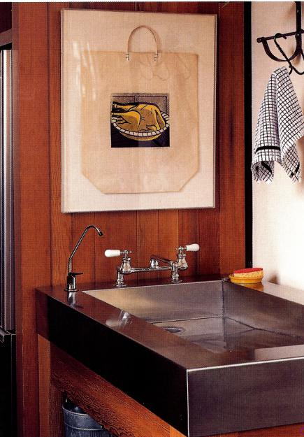 shallow stainless steel sloped utility sink in black window industrial kitchen with Roy Lichtenstein print - Metropolitan Home via Atticmag