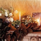 holidays in bloom - magnolia leaf garland and white tulips on a mantel - House & Garden via Atticmag
