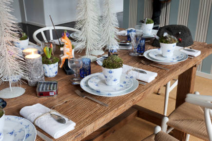 rRoyal Copenhagen's Christmas 2011 fishing theme christmas table with Blue Elements china on a rustic wood table - Royal Copenhagen via Atticmag