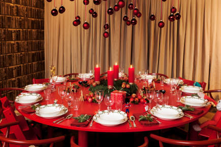 Royal Copenhagen's Christmas 2011 - overview of round red Christmas table set with Fluted Star Christmas china - Royal Copenhagen via Atticmag