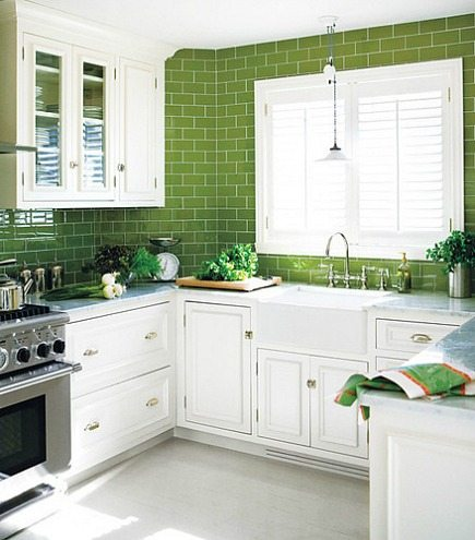 green kitchens - bright green subway tile counter to ceiling backsplash - Style at Home via Atticmag