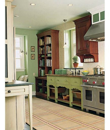 green kitchens - green sink console with open storage shelf below - This Old House via Atticmag