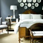 plate display - white plates and black transferware displayed on a bedroom wall above a headboard - Decorpad via Atticmag