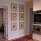 kitchen picture wall - antique Bivort fruit prints in the Yellow Eurosplash Kitchen - Atticmag