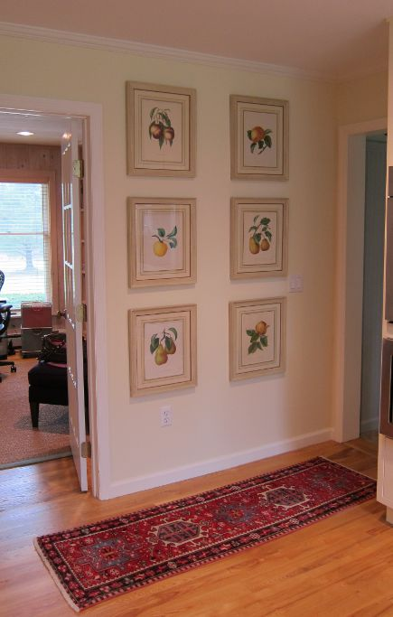 kitchen picture wall - set of six antique Bivort fruit prints hung to cover unused electrical boxes on a kitchen wall - Atticmag