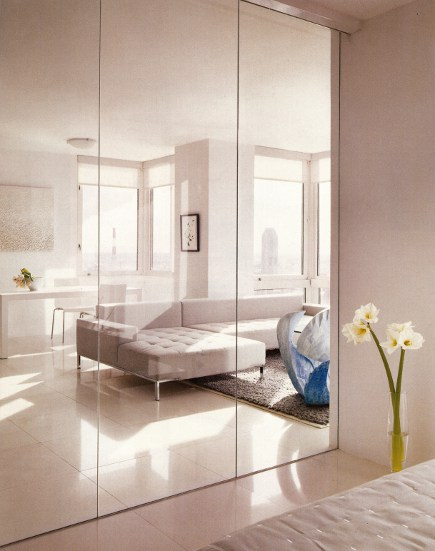 interior glass walls - view of New York City through the glass wall of a apartment bedroom by Jennifer Post - Architectural Digest via Atticmag