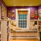 kid's room ideas - window seat alcove with bookshelves on a stairway landing - Smith & Vansant via Atticmag