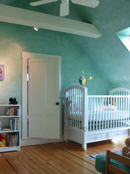 Aqua green Venetian plaster walls in a dormer nursery