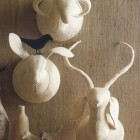 faux deer decor - hand blocked felted wool animal head trophies from Roost Collection via Atticmag
