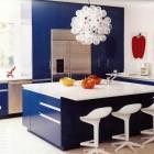 blue kitchen cabinets - contemporary blue and white kitchen with electric blue cabinets and mid-century modern style accessories - Domino via Atticmag