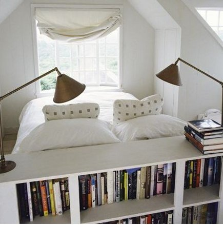 bookcase ideas - bookcase built into the back of a low headboard - via Atticmag