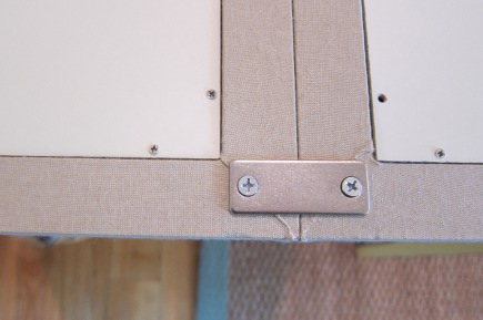 linen pinboard - metal braces on the back of Pottery Barn modular linen pin boards - Atticmag