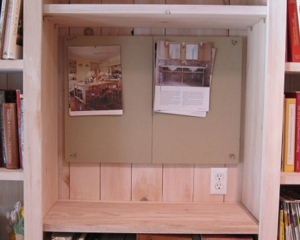 bookcase pinboard - Pottery Barn modular linen pin board installed in bookcase niche - Atticmag