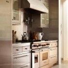 stainless steel range niche in a custom kitchen with stainless cabinets by Ken Linsteadt via Atticmag
