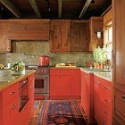 red base cabinets - bold red Shaker style cabinet mountain kitchen by John Oetgen and Sally Ann Sullivan via Atticmag